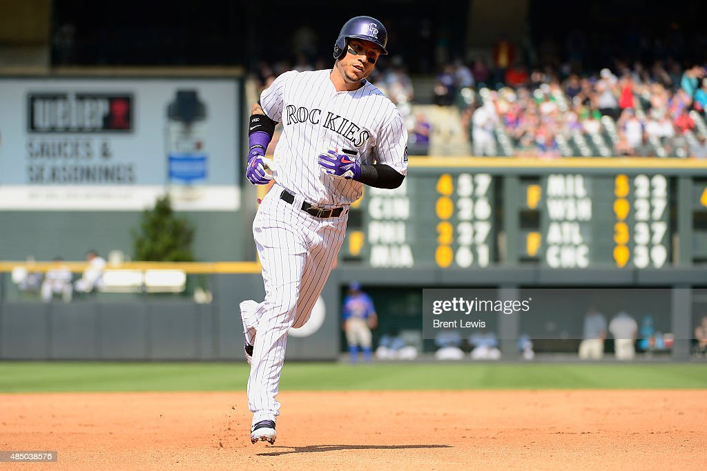 Colorado Rockies right fielder <a gi-track='captionPersonalityLinkClicked' href=/galleries/search?phrase=Carlos+Gonzalez+-+Amerikansk+basebollspelare&family=editorial&specificpeople=7204259 ng-click='$event.stopPropagation()'>Carlos Gonzalez</a> (5) rounds third after hitting a solo home run in the fourth inning August 23, 2015 at Coors Field. The New York Mets defeated the Colorado Rockies 5-1.
