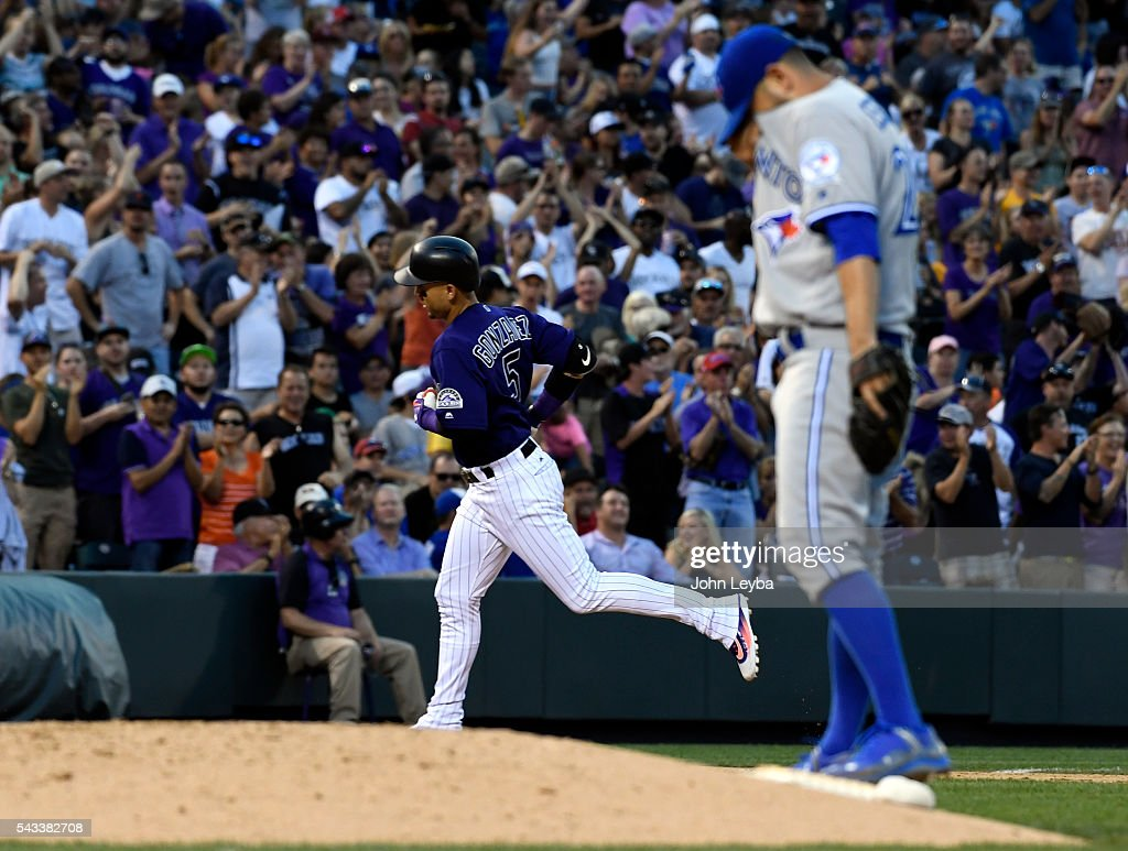 Colorado Rockies right fielder <a gi-track='captionPersonalityLinkClicked' href=/galleries/search?phrase=Carlos+Gonzalez+-+US+Baseball+Player&family=editorial&specificpeople=7204259 ng-click='$event.stopPropagation()'>Carlos Gonzalez</a> (5) rounds third base after his two run home run in the sixth inning off Toronto Blue Jays starting pitcher <a gi-track='captionPersonalityLinkClicked' href=/galleries/search?phrase=Marco+Estrada+-+Baseball+Player&family=editorial&specificpeople=7030137 ng-click='$event.stopPropagation()'>Marco Estrada</a> (25) June 27, 2016 at Coors Field.