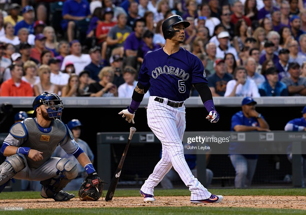 Colorado Rockies right fielder <a gi-track='captionPersonalityLinkClicked' href=/galleries/search?phrase=Carlos+Gonzalez+-+US+Baseball+Player&family=editorial&specificpeople=7204259 ng-click='$event.stopPropagation()'>Carlos Gonzalez</a> (5) watches as his hit sails over right center for a two run home run in the sixth inning against the Toronto Blue Jays June 27, 2016 at Coors Field.