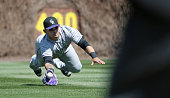 Colorado Rockies right fielder Gerardo Parra dives to catch a ball hit by Chicago Cubs second baseman Ben Zobrist in the first inning at Wrigley...