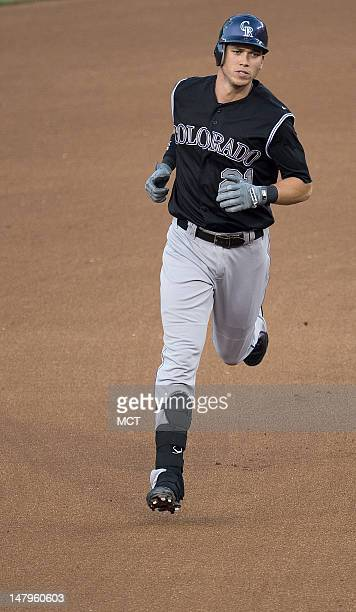 Colorado Rockies right fielder Tyler Colvin rounds the bases after hitting a tworun home run off Washington Nationals starting pitcher Stephen...