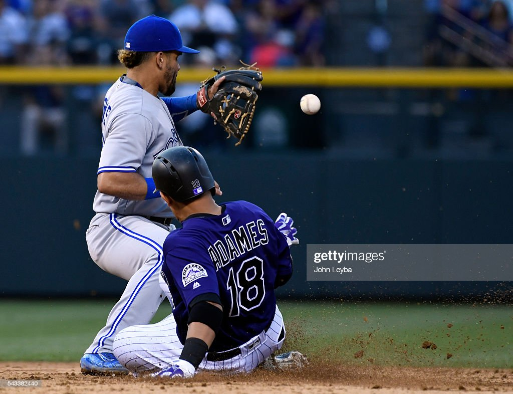 Colorado Rockies second baseman Cristhian Adames (18) slides safe at second base as Toronto Blue Jays second baseman <a gi-track='captionPersonalityLinkClicked' href=/galleries/search?phrase=Devon+Travis&family=editorial&specificpeople=3174405 ng-click='$event.stopPropagation()'>Devon Travis</a> (29) waits for the ball during the sixth inning June 27, 2016 at Coors Field.