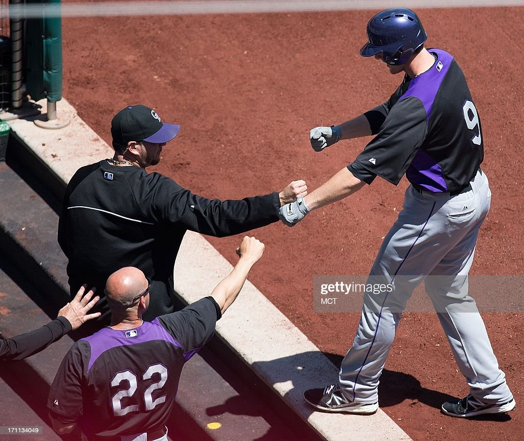 Colorado Rockies second baseman DJ LeMahieu (9) is greeted in the dugout by teammates after hitting a home-run off Washington Nationals starting pitcher Dan Haren (15) during the firstinning at Nationals Park in Washington, D.C, Saturday, June 22, 2013. Colorado defeated Washington 7-1.