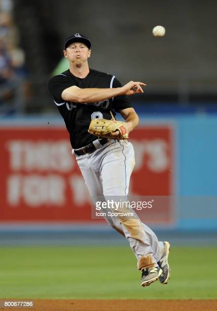 Colorado Rockies second baseman DJ LeMathieu makes a throw to first after fielding a ground ball during the seventh inning of a game against the Los...