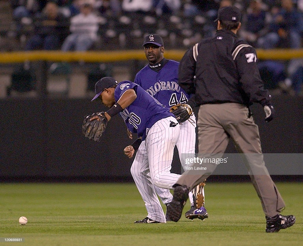 Colorado Rockies second baseman <a gi-track='captionPersonalityLinkClicked' href=/galleries/search?phrase=Ronnie+Belliard&family=editorial&specificpeople=212880 ng-click='$event.stopPropagation()'>Ronnie Belliard</a>, 10, looks down at the ball that fell between him and <a gi-track='captionPersonalityLinkClicked' href=/galleries/search?phrase=Preston+Wilson&family=editorial&specificpeople=213345 ng-click='$event.stopPropagation()'>Preston Wilson</a> on a hit by the Houston Astros' <a gi-track='captionPersonalityLinkClicked' href=/galleries/search?phrase=Lance+Berkman&family=editorial&specificpeople=167176 ng-click='$event.stopPropagation()'>Lance Berkman</a> during the second inng Wednesday Sept. 17, 2003, at Coors Field in Denver, Colorado. Umpire Jim Joyce looks on.