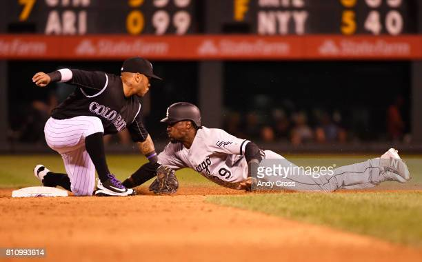 Colorado Rockies shortstop Alexi Amarista tags out Chicago White Sox second baseman Alen Hanson on a steal in the 8th inning at Coors Field July 08...