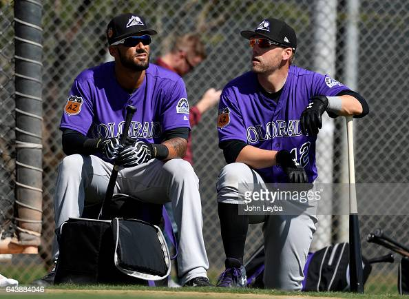 Colorado Rockies shortstop Ian Desmond and Colorado Rockies first baseman Mark Reynolds wait there turn to get int he batting cage for batting...