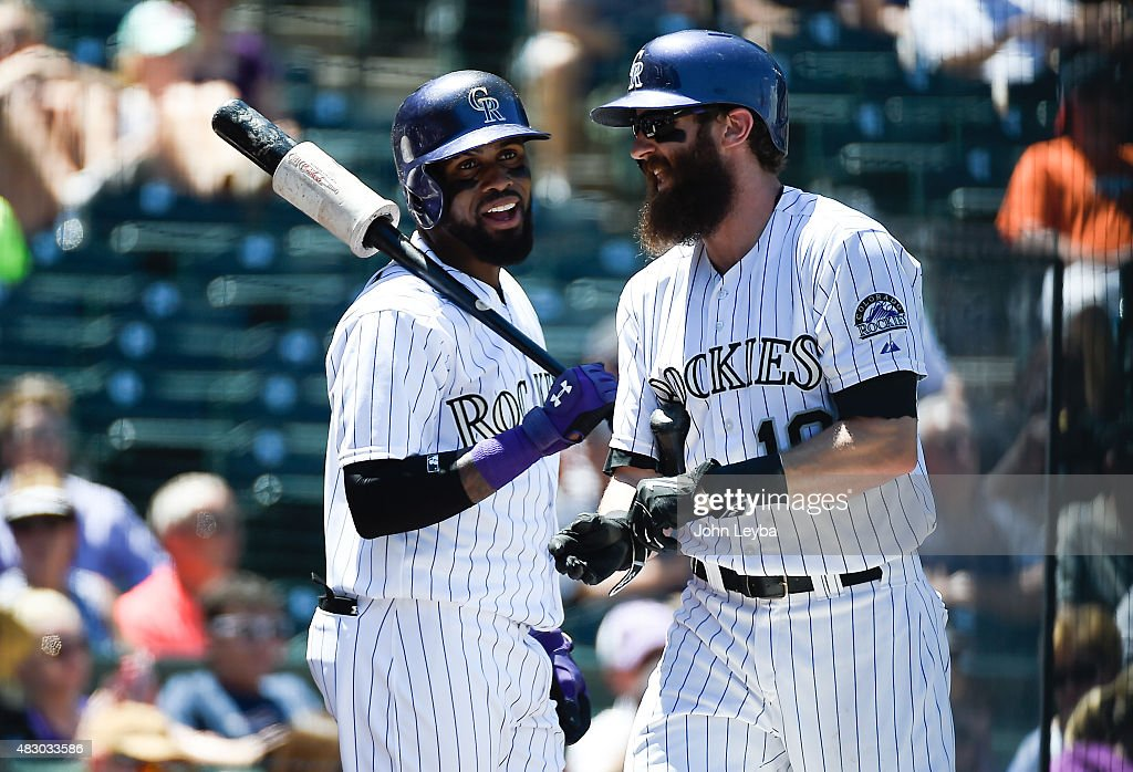 Colorado Rockies shortstop <a gi-track='captionPersonalityLinkClicked' href=/galleries/search?phrase=Jose+Reyes+-+Baseball+Player&family=editorial&specificpeople=203307 ng-click='$event.stopPropagation()'>Jose Reyes</a> (7) smiles at Colorado Rockies center fielder <a gi-track='captionPersonalityLinkClicked' href=/galleries/search?phrase=Charlie+Blackmon&family=editorial&specificpeople=7519880 ng-click='$event.stopPropagation()'>Charlie Blackmon</a> (19) in the on deck circle against the Seattle Mariners August 5, 2015 at Coors Field.