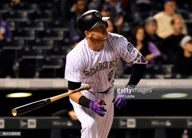 Colorado Rockies shortstop Trevor Story homers to center field scoring third baseman Nolan Arenado and first baseman Mark Reynolds during the first...