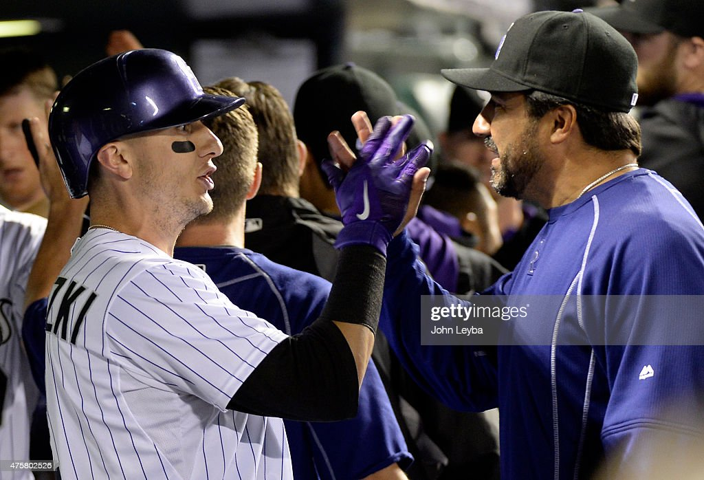 Colorado Rockies shortstop Troy Tulowitzki is congratulated by Vinny Csstilla in the dugout after his home run in the 5th inning against the Los...