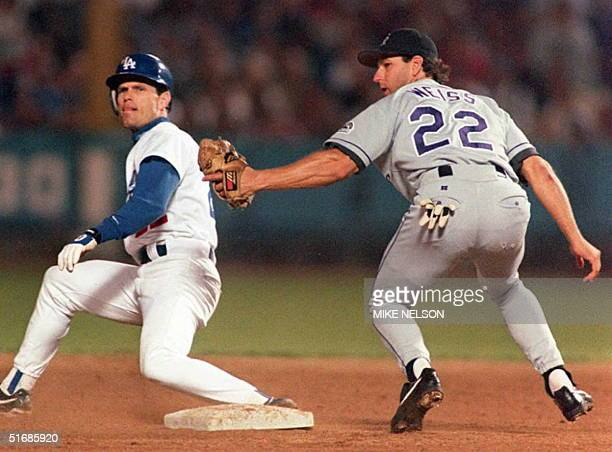 Colorado Rockies shortstop Walt Weiss applies a late tag to Los Angeles Dodgers Brett Butler as he steals second base in the 2nd inning 27 September...