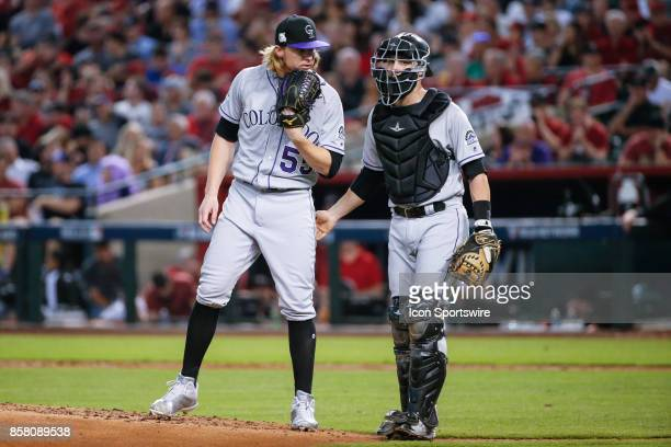 Colorado Rockies starting pitcher Jon Gray and Colorado Rockies catcher Jonathan Lucroy discuss strategy during the MLB National League Wild Card...