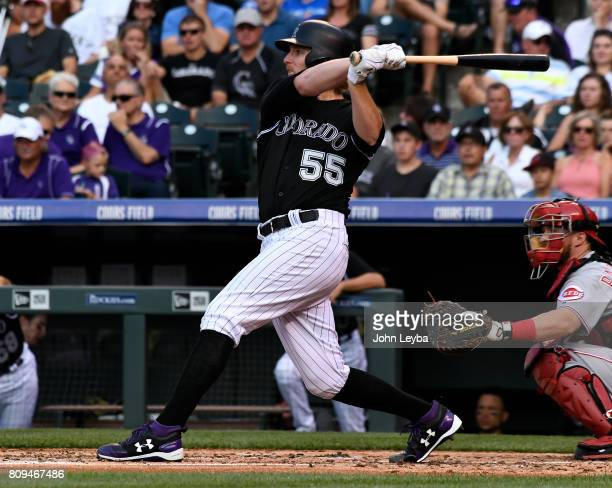 Colorado Rockies starting pitcher Jon Gray watches as his hit sails over the center field wall for a homer against the Cincinnati Reds the second...