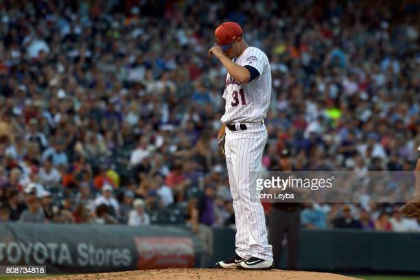 Colorado Rockies starting pitcher Kyle Freeland adjusts his hat as he waits for Colorado Rockies manager Bud Black to visit the mound during the...