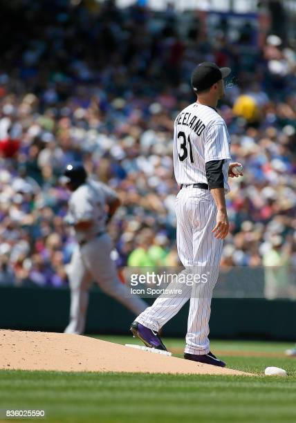 Colorado Rockies Starting Pitcher Kyle Freeland stands at the mound while Milwaukee Brewers Infielder Jesus Aguilar rounds the bases following a solo...