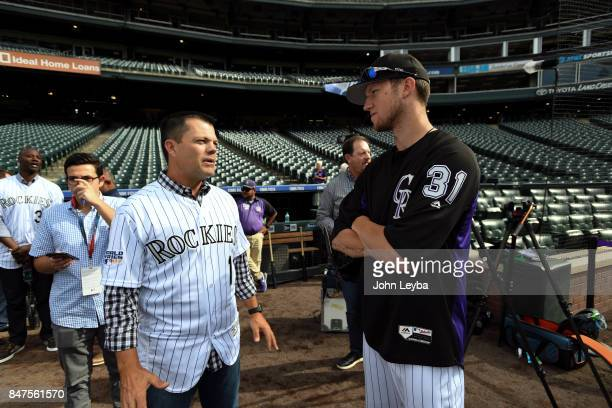 Colorado Rockies starting pitcher Kyle Freeland talks with former Rockies player Jamey Carroll prior to the San Diego Padres game on September 15...