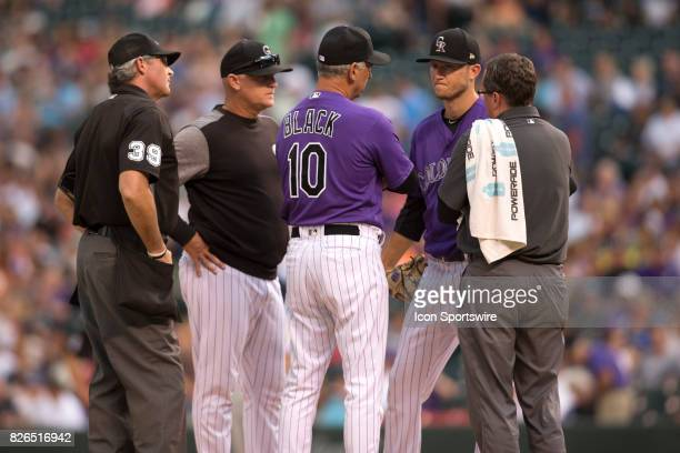 Colorado Rockies starting pitcher Kyle Freeland talks with manager Bud Black before leaving the game in the 1st inning with an injury during the...