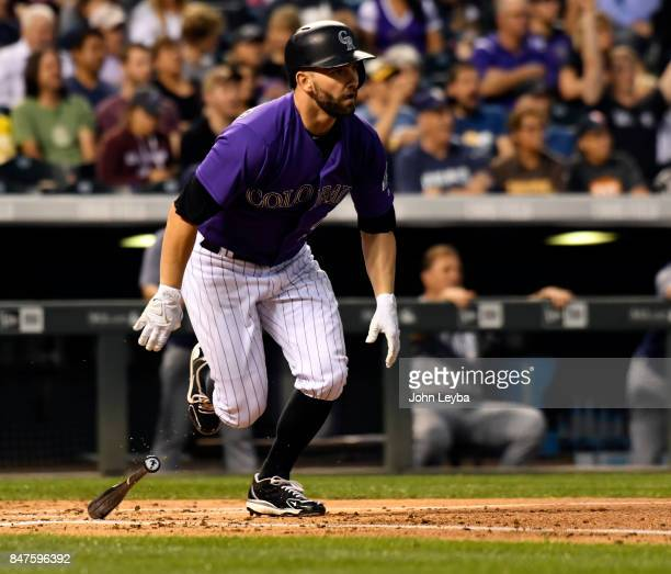Colorado Rockies starting pitcher Tyler Chatwood hits a single to drive in right fielder Carlos Gonzalez and first baseman Mark Reynolds during the...