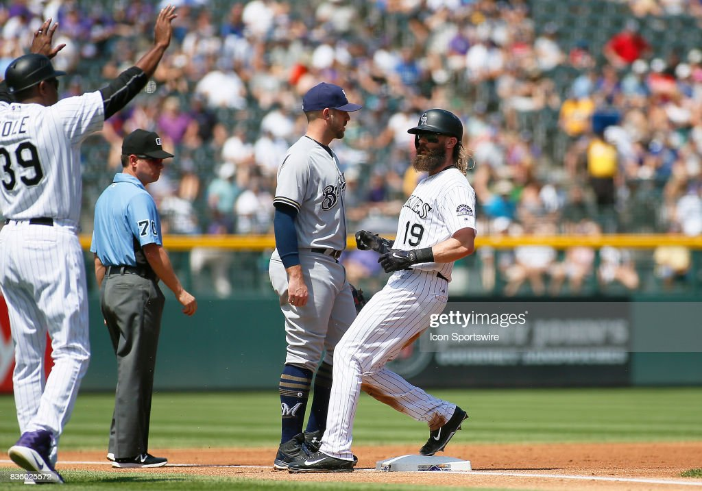 Colorado Rockies Third Base Coach, Stu Cole (39) stops Rockies Outfielder, Charlie Blackmon (19) as he reaches third base during a regular season MLB game between the Colorado Rockies and the visiting Milwaukee Brewers on August 20, 2017 at Coors Field in Denver, CO.
