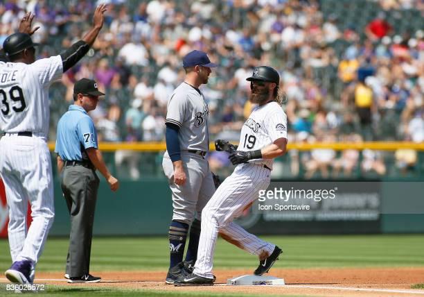 Colorado Rockies Third Base Coach Stu Cole stops Rockies Outfielder Charlie Blackmon as he reaches third base during a regular season MLB game...