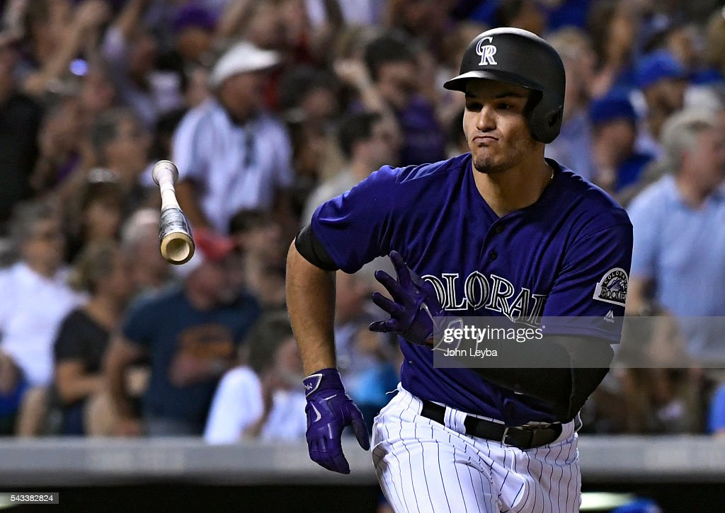Colorado Rockies third baseman <a gi-track='captionPersonalityLinkClicked' href=/galleries/search?phrase=Nolan+Arenado&family=editorial&specificpeople=7934273 ng-click='$event.stopPropagation()'>Nolan Arenado</a> (28) flips his bat towards the dugout after hitting a hard line drive for a single in the seventh inning against the Toronto Blue Jays June 27, 2016 at Coors Field.