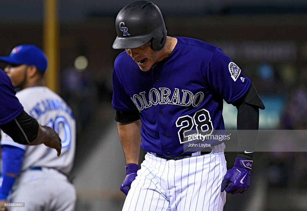 Colorado Rockies third baseman <a gi-track='captionPersonalityLinkClicked' href=/galleries/search?phrase=Nolan+Arenado&family=editorial&specificpeople=7934273 ng-click='$event.stopPropagation()'>Nolan Arenado</a> (28) screams out at first base after hitting a hard line drive for a single in the seventh inning against the Toronto Blue Jays June 27, 2016 at Coors Field.