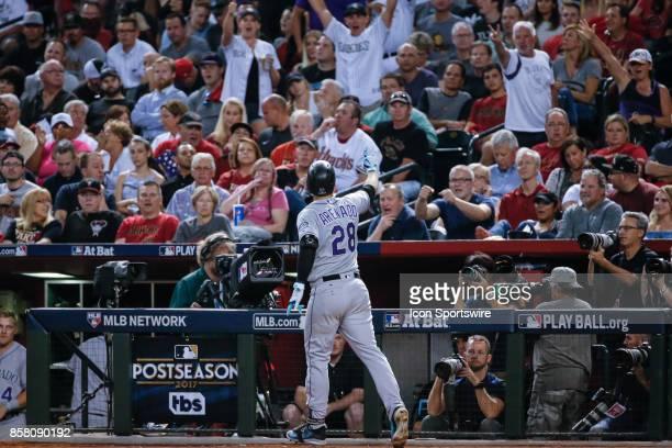 Colorado Rockies third baseman Nolan Arenado waves to Rockies fans after hitting a home run during the MLB National League Wild Card baseball game...