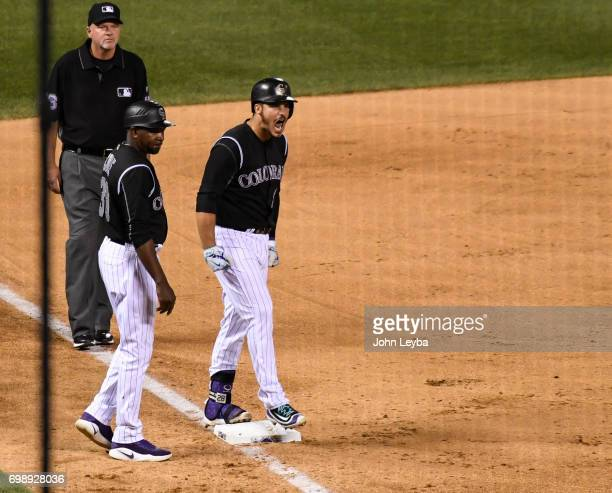 Colorado Rockies third baseman Nolan Arenado yells out as he's stand on third base after his two run triple in the eighth inning to the Rockies up 43...