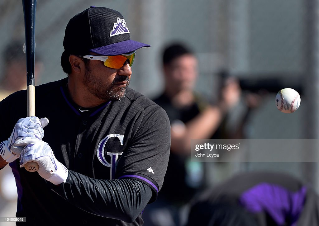 Colorado Rockies Vinny Castilla hits grounders during the teams workout on day 7 of spring training February 27 2015 in Scottsdale