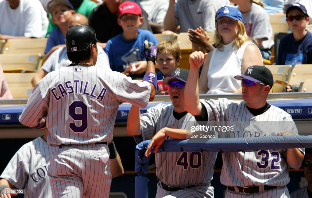 Colorado Rockies Vinny Castilla is greeted by teammates after hitting his 6th inning home run against the Los Angeles Dodgers in Los Angeles...