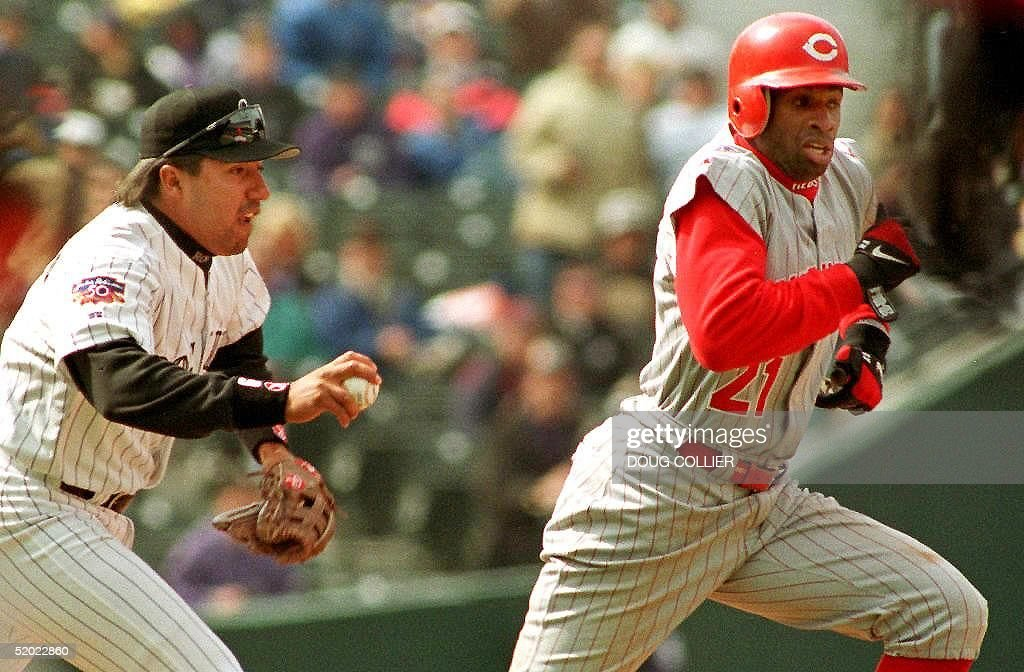 Colorado Rockies' Vinny Castilla runs down Dion Sanders of the Cincinnati Reds for an out in the first inning of their game 09 April at Coors Field...