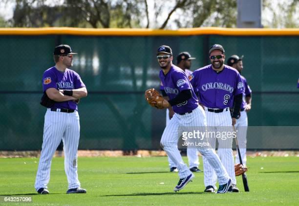 Colorado Rockies Vinny Castilla smiles as Colorado Rockies third baseman Nolan Arenado chases after a ball during batting practice at the teams full...