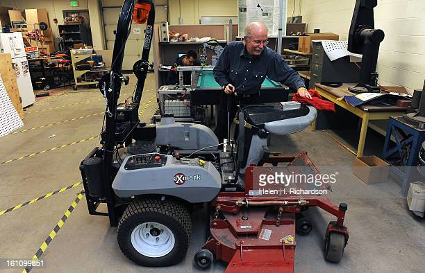 Colorado School of Mines Professor John Steele shows the robotic lawn mower called Weederbot that he and his students have been trying to perfect...