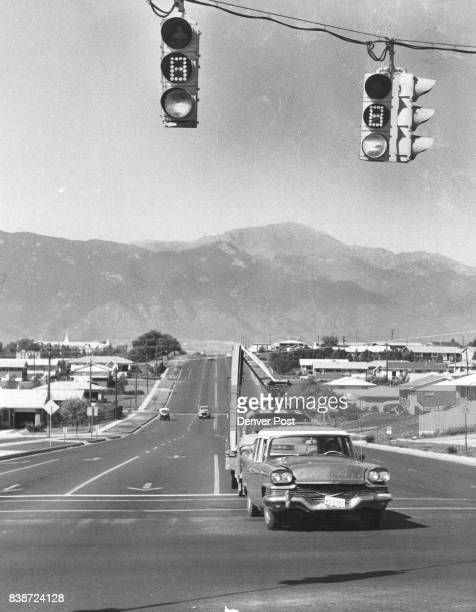 Colorado Springs Colorado 1960 1969 Motorists Approach Novel Lights At Intersection View at E Pikes Peak Ave and N Circle Drive Credit Denver Post