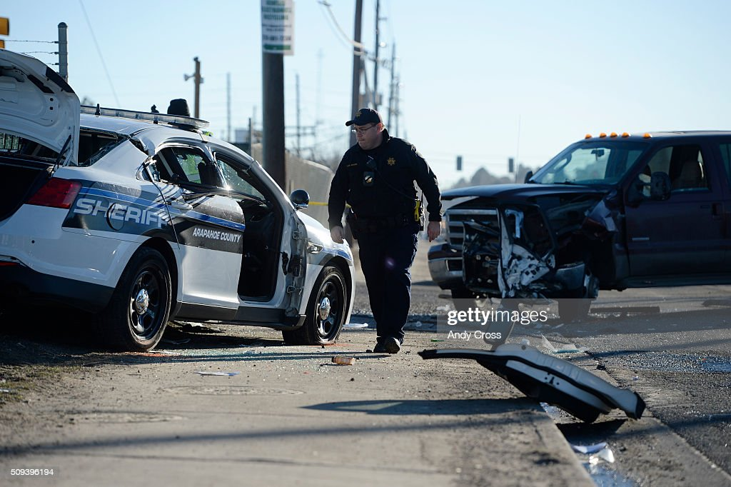 A Colorado State Patrolman investigates a car crash involving a Arapahoe County Sheriff's deputy and a truck at the intersection of Iliff Ave and Valencia St. February 10, 2016. The deputy, who was responding to a nearby sexual assault/homicide, was transported to a local hospital and is in critical, but stable condition.