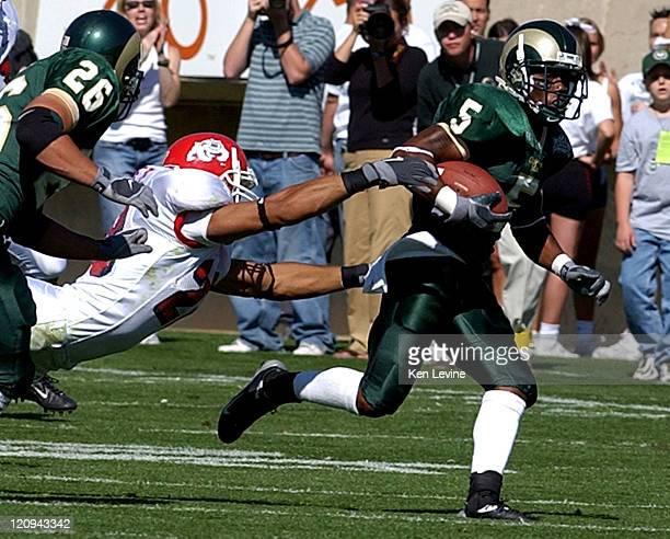Colorado State punt returner Dexter Wynn eludes the diving tackle of Fresno States' Manuel Sanchez during the second quarter Saturday Oct 4 2003 at...