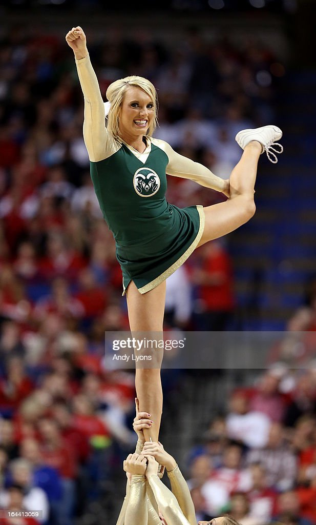 A Colorado State Rams cheerleader performs on the court during a game stoppage in the second half against the Louisville Cardinals during the third round of the 2013 NCAA Men's Basketball Tournament at Rupp Arena on March 23, 2013 in Lexington, Kentucky.
