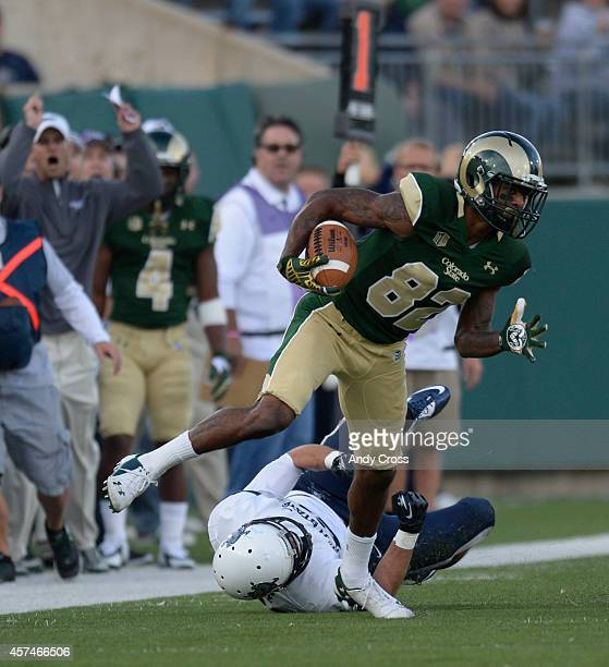 Colorado State Rams wide receiver Rashard Higgins gets past Utah State Aggies safety Brian Suite at the beginning of the game at Sonny Lubick Field...