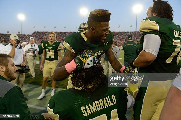 Colorado State Rams wide receiver Rashard Higgins thanks Colorado State Rams offensive lineman Ty Sambrailo on the bench after Higgins caught a pass...