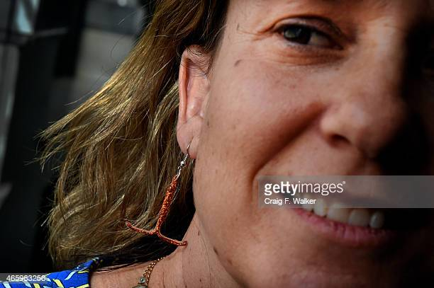 Colorado State Rep KC Becker poses for a portrait with an earring fashioned after an IUD at the State offices in Denver CO March 12 2015 Some law...