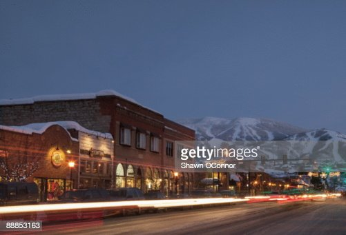 USA, Colorado, Steamboat Springs, Town at night with mountains in background