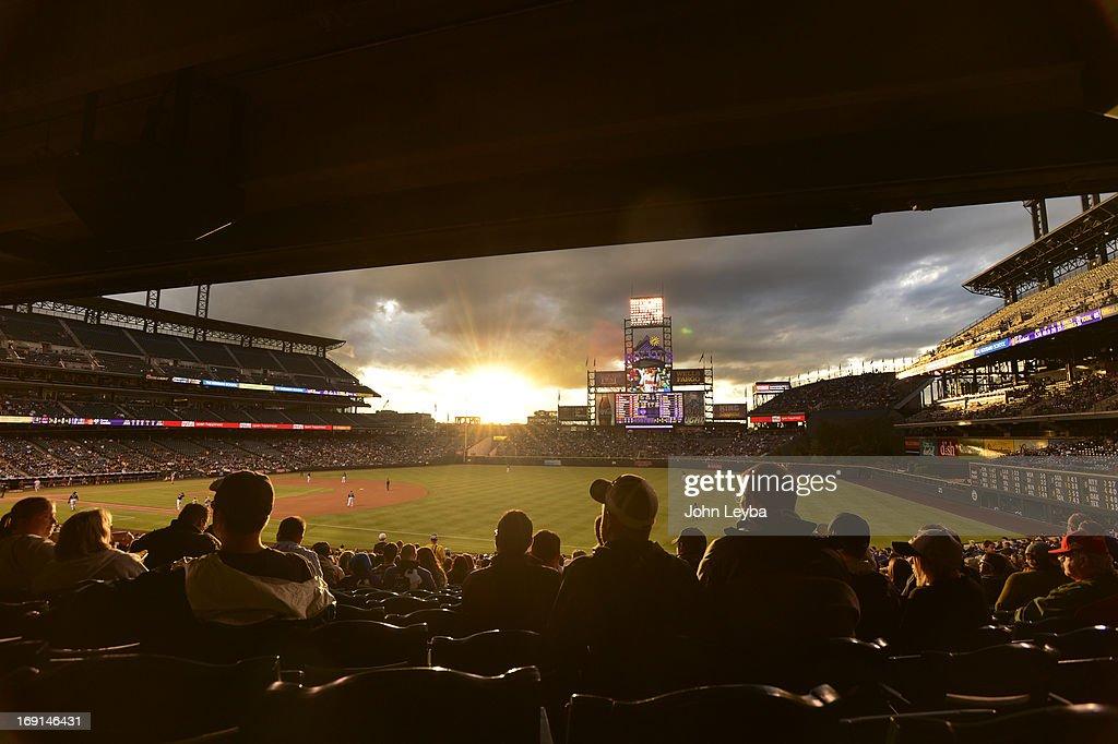 A Colorado sunset beams down through the clouds during the Colorado Rockies Arizona Diamondbacks game May 20, 2013 at Coors Field.