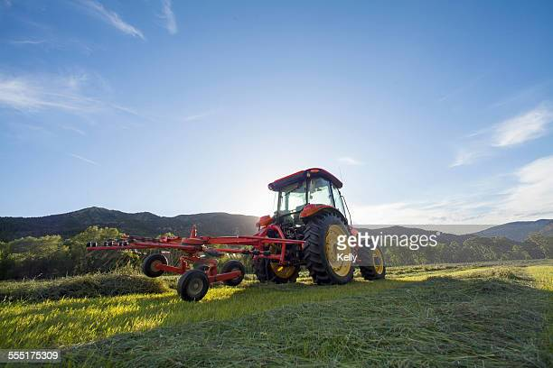 USA, Colorado, Tractor in field at sunset