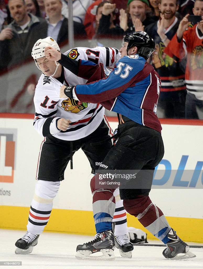 Colorado wing Cody McLeod (55) took a swing at Chicago defenseman Sheldon Brookbank (17) in the first period. The Colorado Avalanche hosted the Chicago Blackhawks at the Pepsi Center Wednesday night, March 12, 2014 in Denver, Colorado.