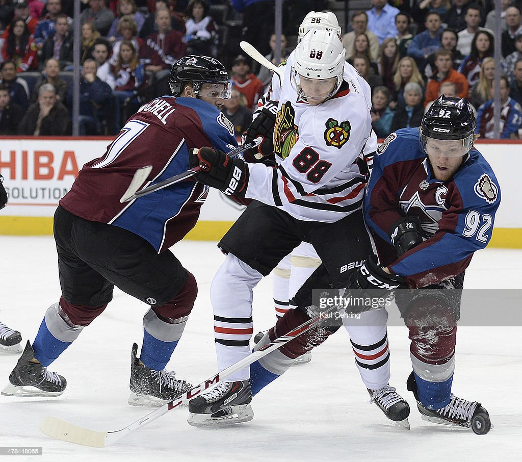 Colorado wing Gabriel Landeskog (92) reached for the puck in front of Chicago wing Patrick Kane (88) in the first period. The Colorado Avalanche hosted the Chicago Blackhawks at the Pepsi Center Wednesday night, March 12, 2014 in Denver, Colorado.