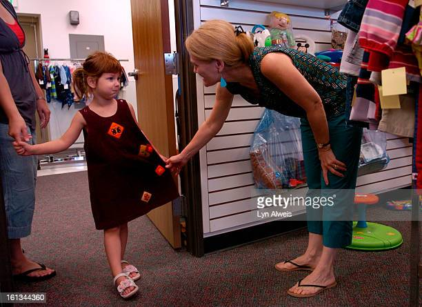 PARKER COLORADOAug7 2007Parents shop for good quality used clothing at the Children's Orchard store in Parker Reagan McCann <cq> age 4 tries on a...
