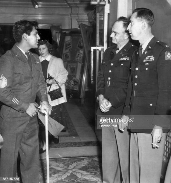 Colorado's first liberated prisoner of war to return from Korea Sgt Ernest Contrearas is shown as he entered the Denham theater for the Rocky...