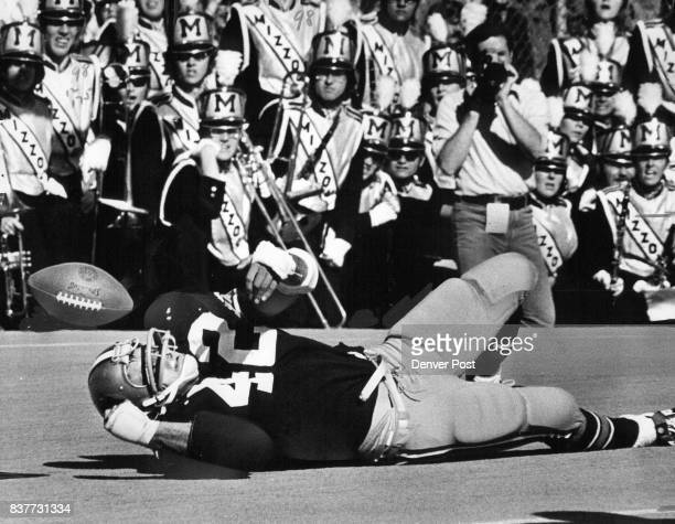 Colorado's Jim Kwlleher watches the ball pop out of his hands after hitting the ground on an attempted pass play in second quarter of Saturday game...