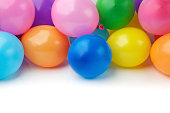multi colored birthday balloons on white background