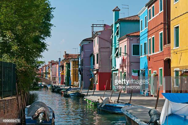 Colored houses along a canal on island of Murano